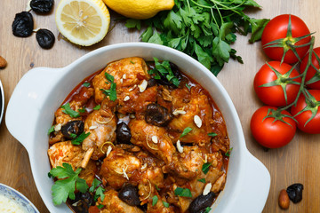 meal of chicken tagine stew in a spicy, nutty tomato sauce and prunes