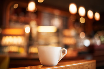 cup of coffee in cafe interior. picture with soft focus and blur