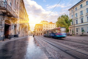 Blue tram rides on the morning  old european city.vintage picture