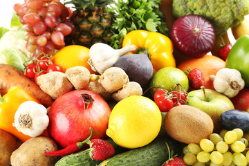 Ripe and tasty fruits and vegetables background