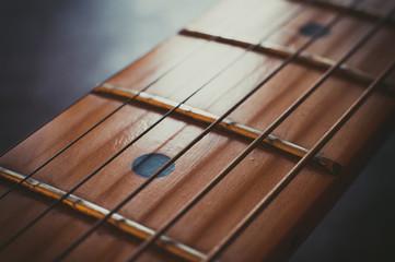 Electric guitar neck detail, music symbol
