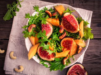 Fig and melon salad with mizuna above