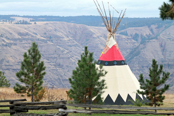 Teepee Behind a Split-Rail Fence Overlooking a Canyon in Oregon
