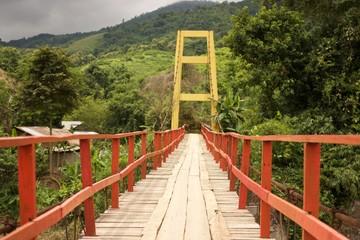 Wooden suspension bridge across the river