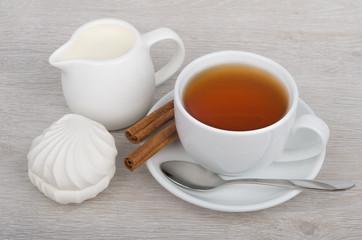 Tea, milk jug and marshmallows on table