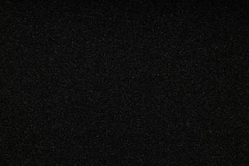 Black monotone grain texture. Glitter sand background. Wall mural