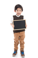 Cute asian boy holding black board on white background