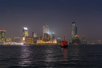 Traditional red junk boat in the Victoria Harbor in Hong Kong at
