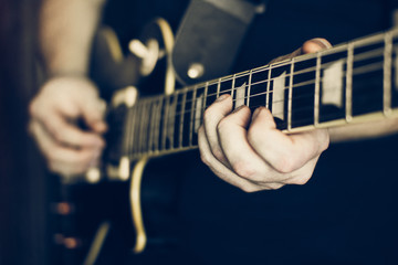 Musician playing electric guitar les paul, hands in focus