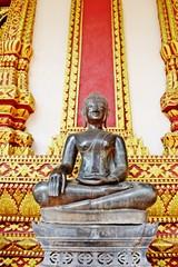 Seated Buddha Image at the veranda's Haw Phra Kaew temple.Vientiane.Laos