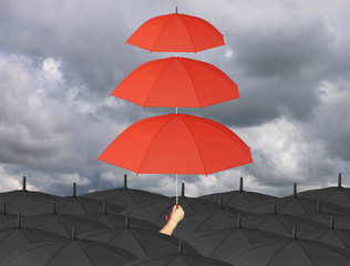Red umbrella third layers in hand and rain protection more than