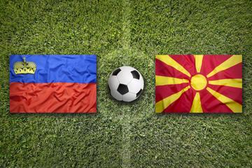Liechtenstein vs. Macedonia flags on soccer field
