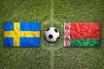 Sweden vs. Belarus flags on soccer field
