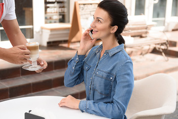Beautiful woman spending time in coffee shop