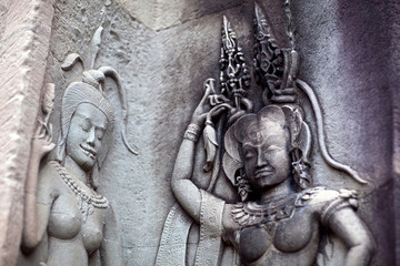 Ancient bas-relief with Apsaras in Angkor Wat, Cambodia