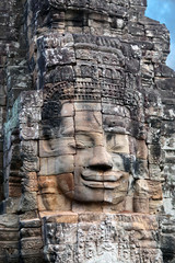 Giant stone face at Prasat Bayon temple in Angkor Thom, Cambodia