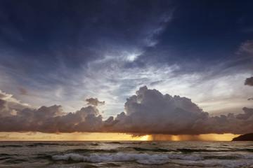 Calm sea on the sunset sky background blue