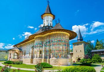 Fototapeta Sucevita orthodox painted church monastery protected by unesco heritage, Suceava town, Moldavia, Bucovina, Romania