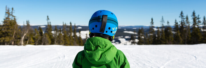 Panorama of young skier