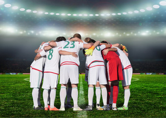 Football team players Hug the neck and for pray before playing