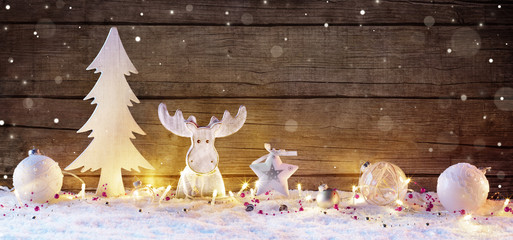 White Christmas Decoration With Lights On Wooden Natural Background