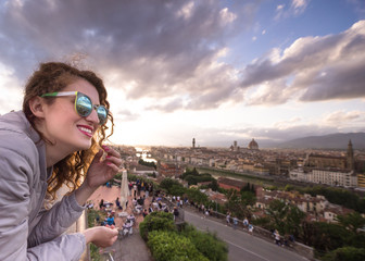 A young attractive woman at suntet, Ponte Vecchio, Florence, Tuscany
