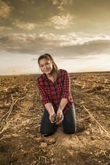 Farm girl at potato harvest