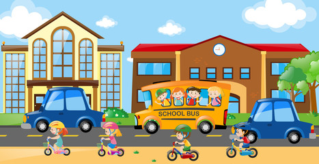 Children riding on bike and bus