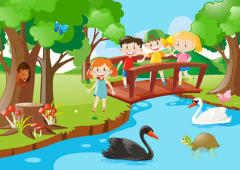 Kids on the bridge and animals in the park