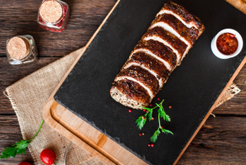 Succulent grilled fillet served with tomato on an wooden board