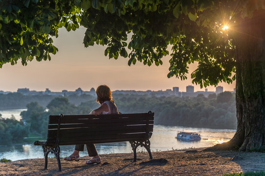 woman sitting on the bench, Belgrade, Serbia