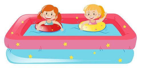 Two girls swimming in small pool