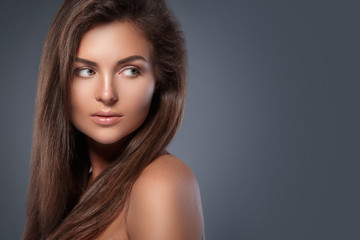 Beautiful woman with perfect skin and nude make-up