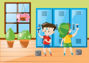 Boys painting lockers blue