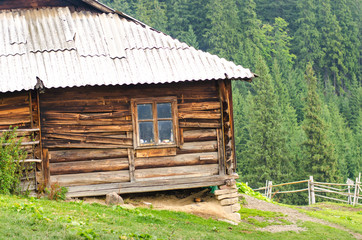Nature wooden houses in a Carpathian mountains.