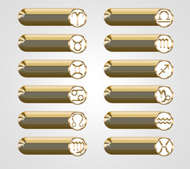 Golden buttons with the astrological signs of the zodiac