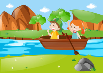 Two kids rowing boat