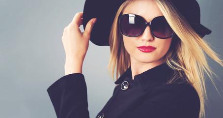 Beautiful blonde woman in a black coat