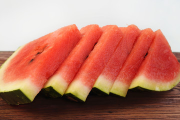 Slices of red watermelon on wooden board