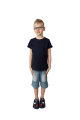 Cute boy in glasses and short jeans stays modestly lowered hands at sides - full height portrait isolated on square white background