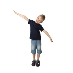 Cute boy in short jeans depicts an airplane flight - full height portrait isolated on square white background