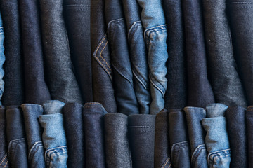 Blue jeans on a brown wooden background and Blue jeans denim Col