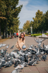 Girl with pigeons in sunglasses