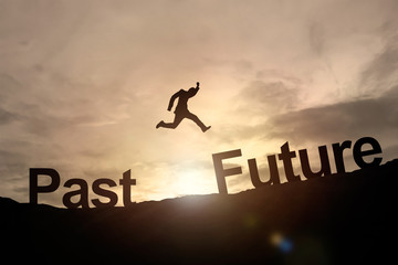Silhouette of businessman glowing jump past to future. success c Wall mural