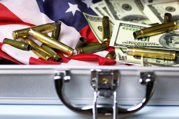 bullet and money dollar on the silver case