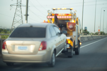 Towing a trailer on the highway.