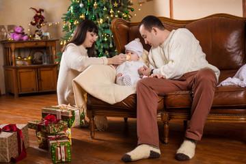 happy family under new year tree