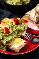 Mexican chimichanga with guacamole dip