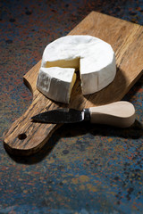 Camembert cheese on a cutting board