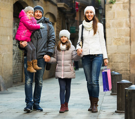 Winter portrait of adults with daughters. Focus on girl. Focus on girl
